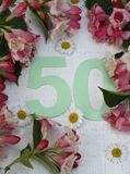 Bastante 50 y flores Fotografía de archivo libre de regalías