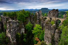 Bastei bridge in Saxon Switzerland, at sunrise and the mist over the river Elbe, National park Saxon Switzerland. Beautiful German. Bastei bridge in Saxon Stock Images