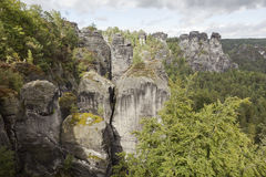 Bastei. Rock formations. Germany. Natural Park Bastei, Saxony, Germany - 7 september, 2015: Complex sandy cliffs, towering above the surface. Between the rocks Royalty Free Stock Images