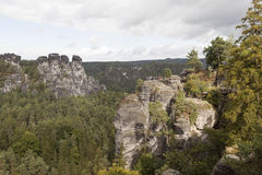 Bastei. Rock formations. Germany. Natural Park Bastei, Saxony, Germany - 7 september, 2015: Complex sandy cliffs, towering above the surface. Between the rocks Royalty Free Stock Photo