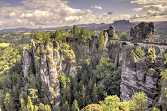 Bastei. Rock formations. Germany. Natural Park Bastei, Saxony, Germany - 7 september, 2015: Complex sandy cliffs, towering above the surface. Between the rocks Royalty Free Stock Photos