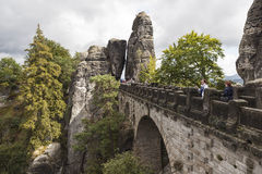 Bastei. Rock formations. Germany. Natural Park Bastei, Saxony, Germany - 7 september, 2015: Complex sandy cliffs, towering above the surface. Between the rocks Royalty Free Stock Image