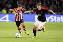 Bastian Schweinsteiger Manchester Unied and Santiago Arias PSV Eindhoven Royalty Free Stock Image