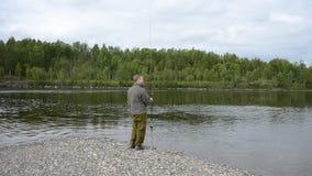 Bastidor de color salmón del pescador y vacilación en la línea metrajes