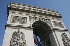 Bastille Day. The Arc de Triomphe at the Champs Elysees in Paris on Bastille Day, with the French flag Stock Image