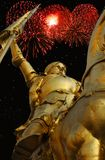 Bastille Day - Joan of Arc. Night time  image of bronze statue of Joan of Arc on Rue de Rivoli in Paris with red fireworks in the background Royalty Free Stock Images