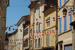 Bastille day in Provence, France. Flags adorning buildings to celebrate Bastille Day. Taken in Dieulefit, Provence, France stock photo
