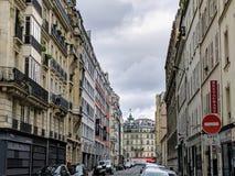 Bastille monument behind the buildings in Paris France
