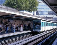 Bastille railway station, Paris. Metro train alongside the platform at Bastille railway station with passengers waiting, Paris, France, Western Europe Stock Images