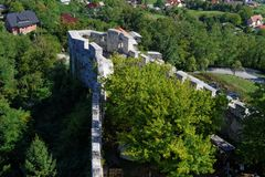 Bastion of Celje medieval castle in Slovenia. Among trees Royalty Free Stock Photo