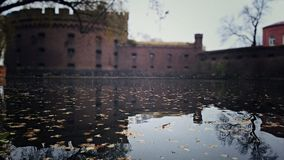 Bastion. In the reflection of the water, the leaves visible through the walls of the Bastion Wrangel Stock Photography