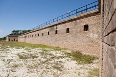 A bastion wall along the outside of Historic Fort Gaines in Dauphin Island Alabama. This is a view of the outside of a bastion wall at Fort Gaines in Dauphin Royalty Free Stock Photo