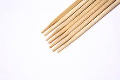 Bastoncini di legno su un fondo bianco Fotografia Stock