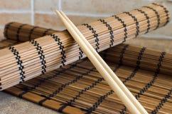 Bastoncino e panno di legno asiatico Immagini Stock