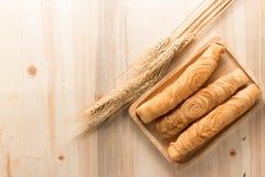 Bastone del soffio del curry su fondo di legno Fotografia Stock