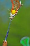 Bastone di lacrosse delle ragazze con la sfera Fotografie Stock