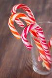 Bastones de caramelo en un vidrio Fotografía de archivo libre de regalías