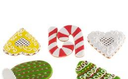 Bastones de los pares de las galletas de la Navidad y dos corazones Foto de archivo libre de regalías