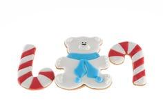 Bastones del oso blanco y de los pares de las galletas de la Navidad Imagen de archivo libre de regalías