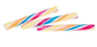 Bastoni colorati della caramella isolati Immagine Stock