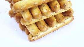 Bastoni del biscotto con i semi di papavero stock footage