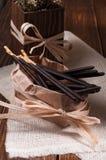 Bastoni del cioccolato in sacco di carta e ciotola Fotografie Stock