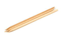 Bastoni di legno arancio (spingitoi della cuticola) per il manicure Fotografie Stock Libere da Diritti