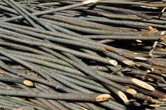 Bastoni di legno per la costruzione della rete fissa Fotografia Stock