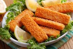Bastoni di pesce croccanti Immagini Stock