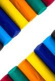 Bastoni variopinti dell'argilla isolati su priorità bassa bianca. Fotografia Stock Libera da Diritti