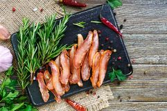 Basturma. Jerky. Pieces of meat with red pepper. Traditional Asian meat appetizer. Delicacy. Flat lay. The top view Royalty Free Stock Photo