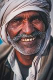 Indian elder smiling to the camera Royalty Free Stock Photos