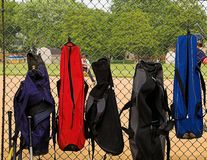 Bat bags on fence Stock Images