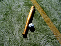 Bat ball & astroturf. A British rounders bat and ball on astroturf playing surface with line marking in shot Stock Photos