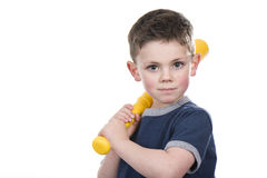 Bat Boy. Young boy holding a bat on his shoulder on a white background royalty free stock images