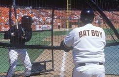 Bat Boy observing pitcher. Rear view of Bat Boy observing pitcher at Baseball game, Candlestick Park, San Francisco, CA Royalty Free Stock Photo