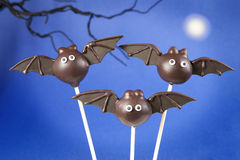 Bat cake pops. Round-shaped mini cakes dipped in  chocolate and decorated with fondant Royalty Free Stock Photography