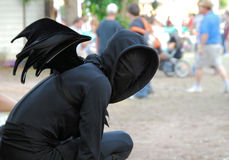 Bat costume. Person in black bat costume at the Texas Renaissance Festival.  The Texas Renaissance Festival in Plantersville is one of the largest and oldest of Stock Photo