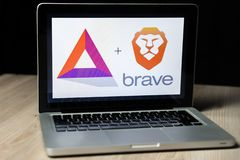 BAT cryptocurrency and Brave browser logo on a laptop screen, Slovenia - December 23th, 2018. Closeup photo of BAT cryptocurrency and Brave browser logo on a royalty free stock photos