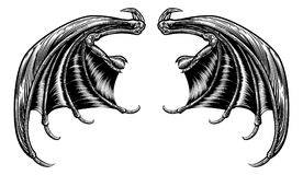 Bat or Dragon Wings. A set of dragon, bat or other scary wings in a retro woodcut engraving style stock illustration