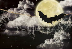 Bat. In front of the moon on a bright Halloween Stock Image