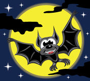 Bat in front of yellow moon and night sky Stock Images