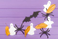 The bat, ghosts and spiders different paper silhouettes with autumn leaves made of halloween corner frame Stock Photography
