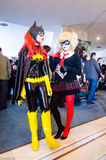 Bat Girl and Harley Quinn cosplayers Stock Photo