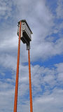 Bat House. A ground level view of a homemade batbox attached to steel pipes and raised 20 feet off the ground Stock Photos