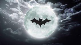 Bat Large Halloween moon dark sky. Bat shadow at color halloween moon stock footage