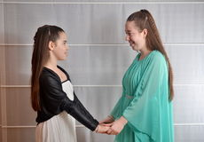 Bat Mitzvah girl with her older sister Stock Images
