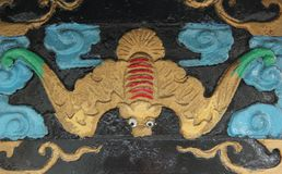 Bat Relief. A colorful bat plaster relief on the walls at one of the ancestor temples in Hong Kong, China royalty free stock photography
