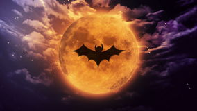 Bat shadow at white moon in space. Bat shadow at pumpkin color halloween moon stock footage