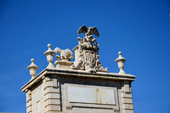 Bat statue. A statue of a bat and the coat of arms of Valencia Royalty Free Stock Photos